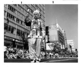 Parade : [Man in Native American clothing in 1967 P.N.E. Opening Day Parade]