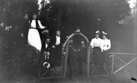 [Group of men and women assembled around entrance arch for trail leading to recreation grounds, S...