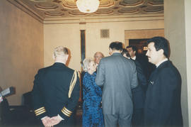 Jeanne Sauvé speaking with a group of men at the Distinguished Pioneer Award Ceremony