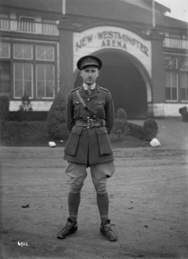 [Soldier in uniform in front of New Westminster Arena]