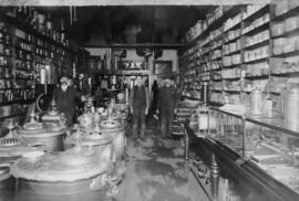 Interior of  Magloire Desrosiers' store, his assistants and their wares