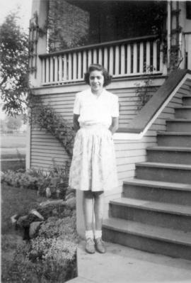 Marion Armstrong [standing beside 3500 Willow Street, Vancouver, B.C.]
