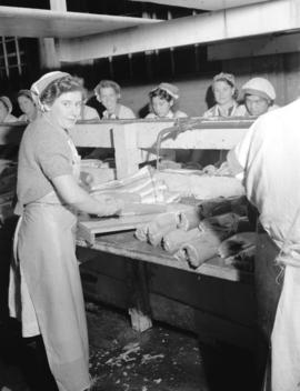 Workers in salmon cannery