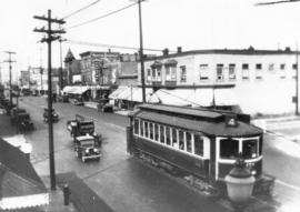 [View looking north along Commercial Drive at 2nd Avenue from an apartment on the southwest corner]
