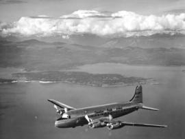 "[Canadian Pacific Airlines] ""Empress of Vancouver"" over city of Vancouver"