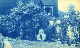 Mrs. Sloan and her garden and [?] side of 44 Hamilton Avenue