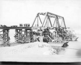 Second Narrows Bridge, 6th March 1925. Shewing [sic] steel span in position ready for lowering on...
