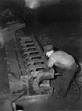 [Man at work at Vancouver Engineering Works]