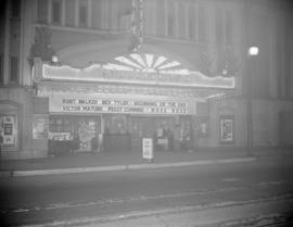 [Exterior view of the Stanley Theatre showing the Christmas ticket booth and cartoon party display]