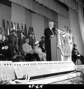 Lieutenant Governor G.R. Pearkes speaking at 1967 P.N.E. opening ceremonies on Outdoor Theatre stage
