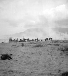 [Troops landing on shore at Kitsilano Beach during war games exercise]