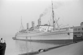 "[The ""Empress of Canada"" at dock]"