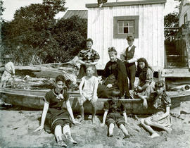 [Group in front of Camper's Cottage at English Bay Beach]