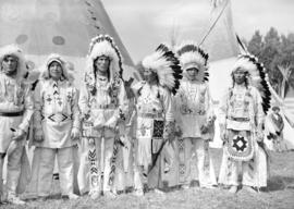[Group portrait of Stoney Indian Chiefs in traditional costumes at the Calgary Stampede]