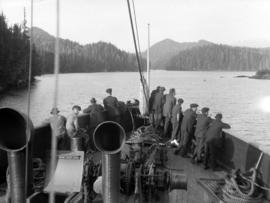 "[Men at the prow of the S.S. ""Camosun"" in Schooner Pass]"