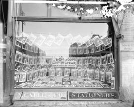 [Storefront window of N. Caple and Co. stationers at 546 Granville Street, display copies of the ...
