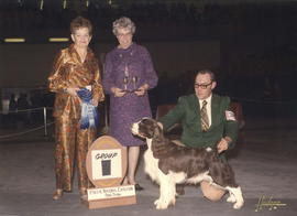 Group one [Sporting Group: Springer Spaniel] award being presented by judge J.S. Fletcher at 1975...