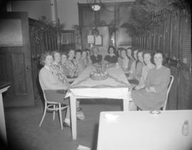 [B.C. Telephone employees sitting around a table at a party]