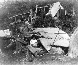 "[Men making ""Kus-kis"" in camp at] New Westminster"