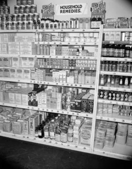 [Household remedies and food products display at a grocery store]