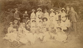 Outdoor group portrait of young men and women