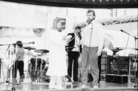 Unidentified man and woman on stage