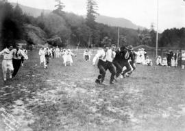 [Picnic ground scene - men's three-legged race]