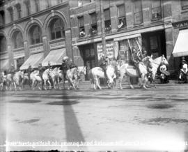 [Ringling Bros. circus mounted band passing 160 Hastings Street]