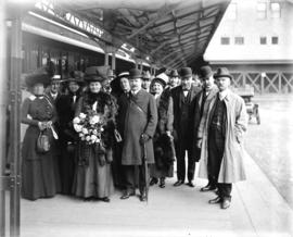 Sir Joseph and Lady Ward [with group on R.R. platform]
