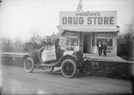 [People in automobile in front of] Gordon's Drug Store