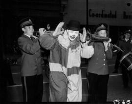 Clown and marching band performers in in 1959 P.N.E. Opening Day Parade