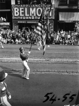 Majorette carrying American flag in 1954 P.N.E. Opening Day Parade