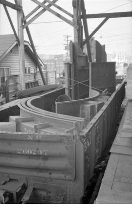 [Metal materials and supplies in a rail car at Vancouver Engineering Works]