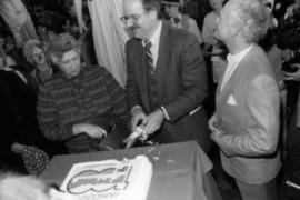 Pat Carney and Mike Harcourt cut cake