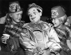 Johnny Cirillino, clown, with children at P.N.E.-Shrine Circus