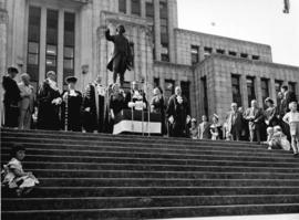 [His Worship Fred J. Hume speaking outside City Hall]