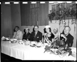 Carol Lucas, Miss P.N.E., with P.N.E. President W.J. Borrie and others at dinner