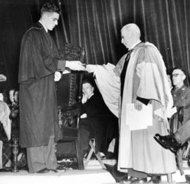[John Pearson presenting key to Brock Memorial Hall at U.B.C. to Dr. R. E. McKecknie]