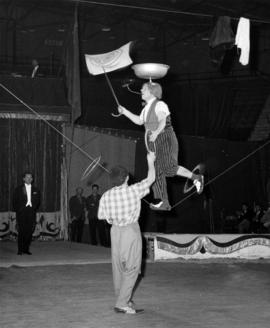 Clown tightrope and spinning act in Moscow Circus performance
