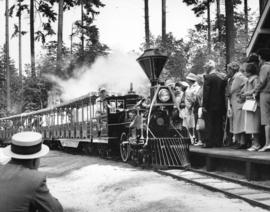 [People await the miniature train during the 75th Anniversary celebrations of the park]