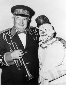 Henry Kyes and Al Ackerman : [publicity photo of man in costume and clown]