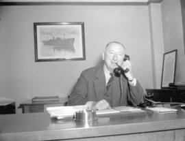 Mr. H.R. Stevenson in his office