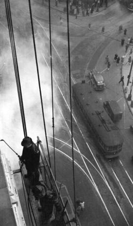 [Workers cleaning the exterior of the Dominion Bank Building]