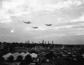 Lancaster bombers flying over P.N.E. grounds in Aviation and Transportation Day fly-past event