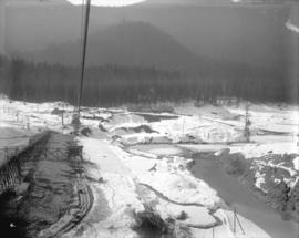 [Coquitlam Dam site covered in snow, looking west along line of upstream]