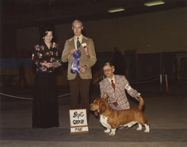 Best in Group [Hound Group: Bassett Hound] award being presented at 1976 P.N.E. All-Breed Dog Show