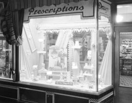 [Millbank Cigarette display in window of an Owl Drug store]