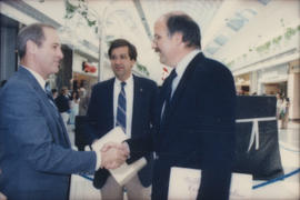 Mike Harcourt shaking hands with unidentified man