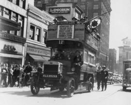 [London Omnibus] passes up Hastings Street near Homer with war veterans aboard