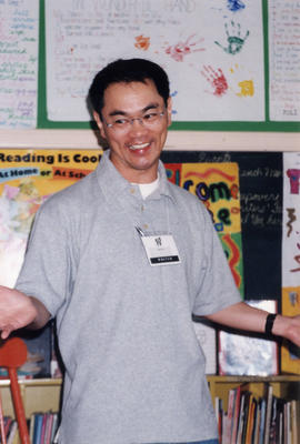 Paul Yee reading at Macdonald Elementary School, Vancouver, during Vancouver International Writer...